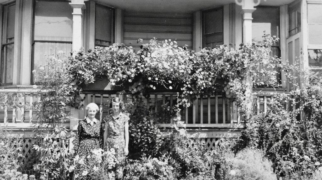 642 Battery Street - Caroline and Carrie Nairne in front of the house and their beautiful garden. probably C.1928 when Carrie would have been 25.