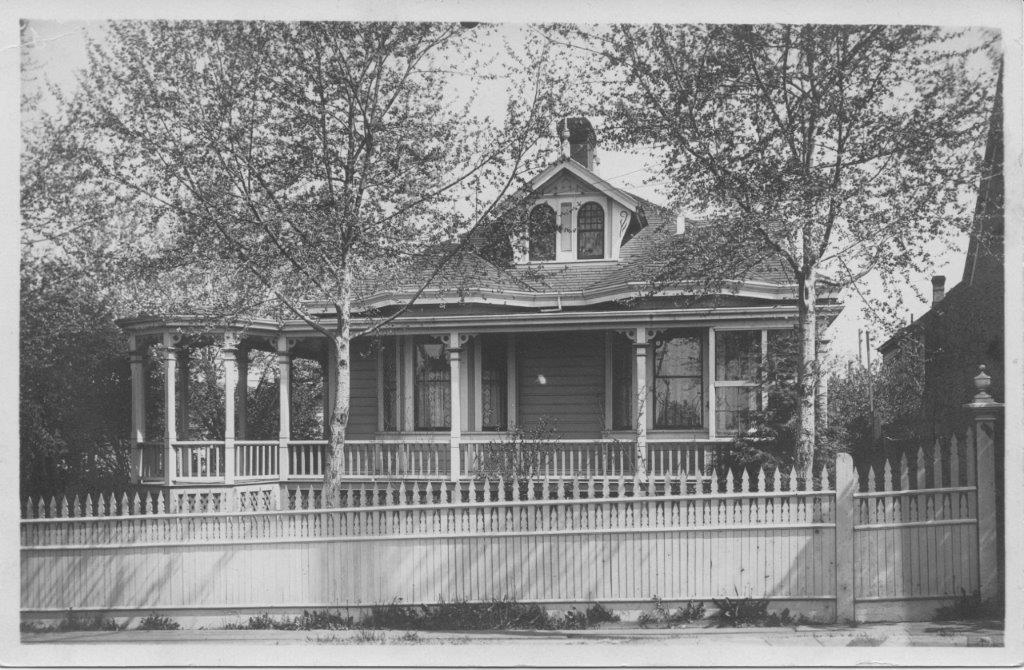 642 Battery Street - the picture of Pamela and Mark used to help Vintage Woodworks replicate the fence. Judging by the trees the author estimates the picture to be c.1905.