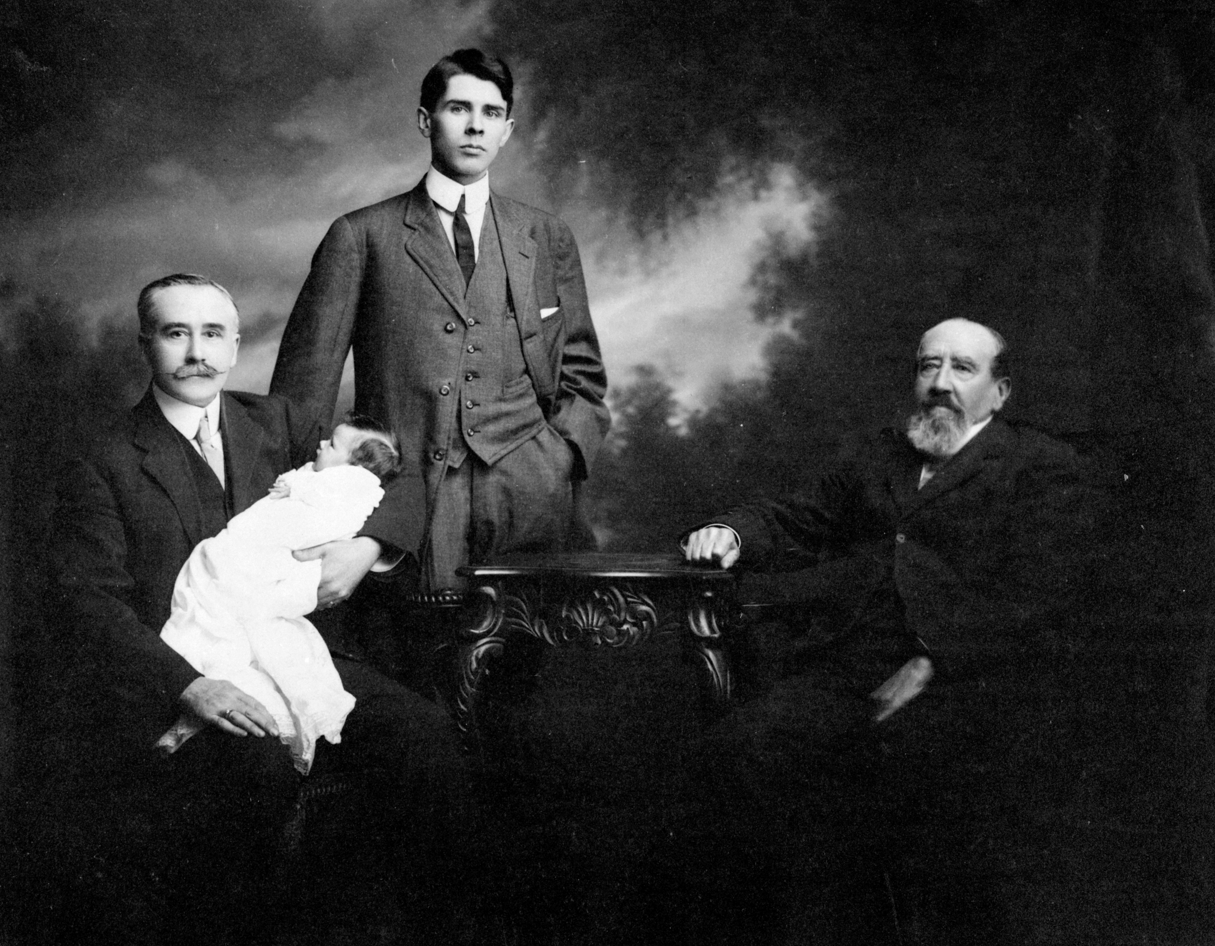 Four generations of the Kent family: Herbert holding his granddaughter Marion; son Daryl and father Charles. 28 March 1913.  Image  F-02018_141 courtesy of the Royal BC Museum Archives.