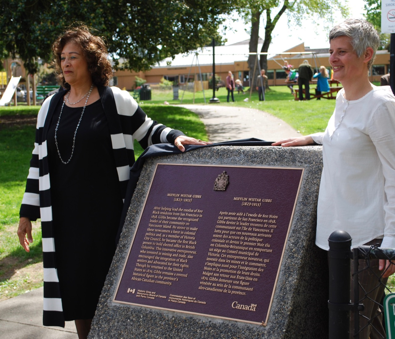 Above Mayor Lisa Helps and Dr. Verna Gibbs unveil plaque honouring Mifflin Wistar Gibbs .  Photo by Robert Hawkes.
