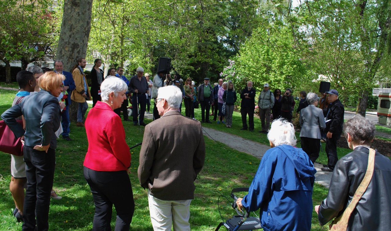 Residents and officials gathered in Irving Park for the ceremony. Photo by Robert Hawkes.
