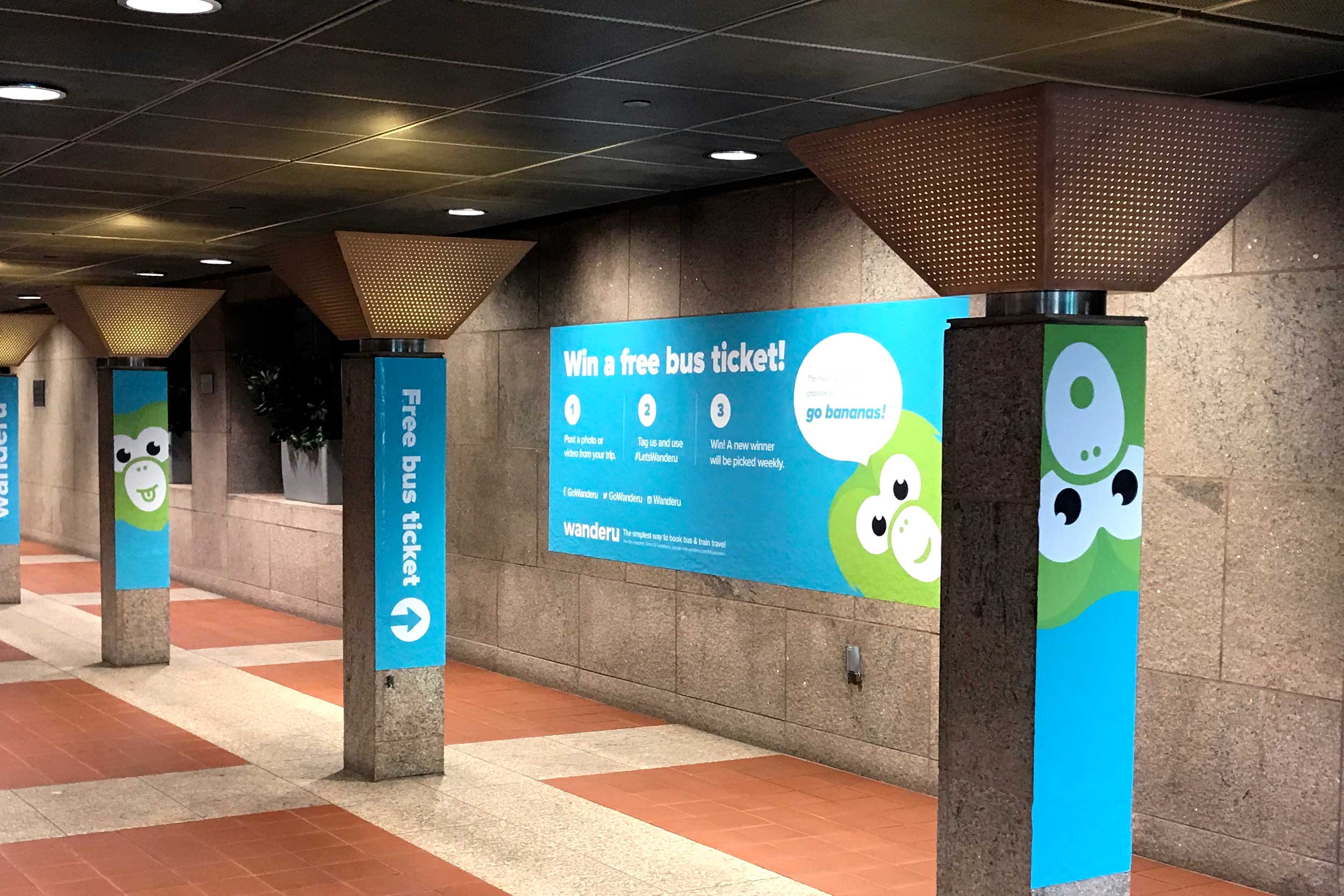 Wanderu South Station takeover campaign • column wraps