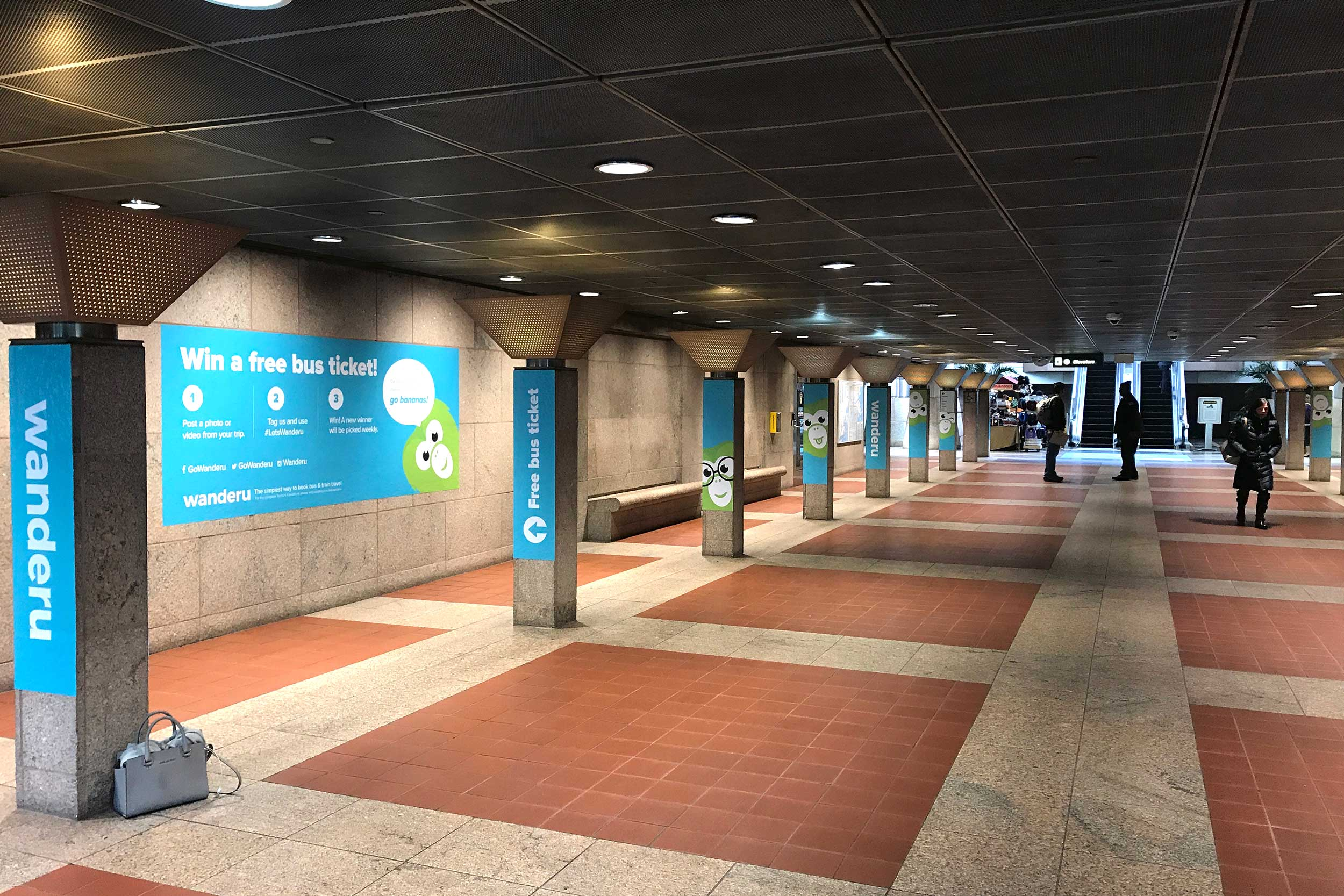Wanderu South Station takeover campaign • entrance to bus terminal
