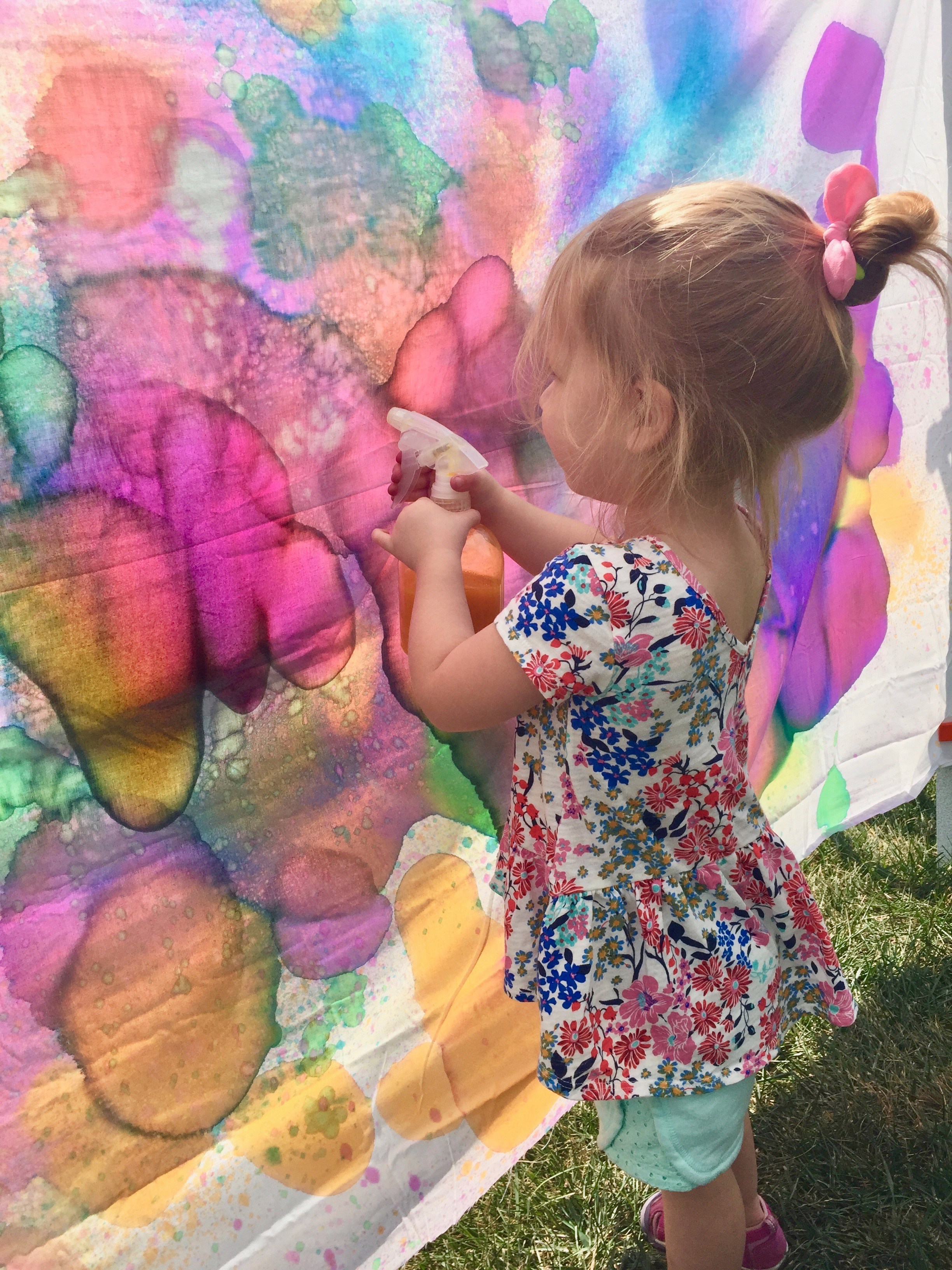 Spray art fun!!! Using liquid  watercolors  and any piece of fabric, equals hours of fun!