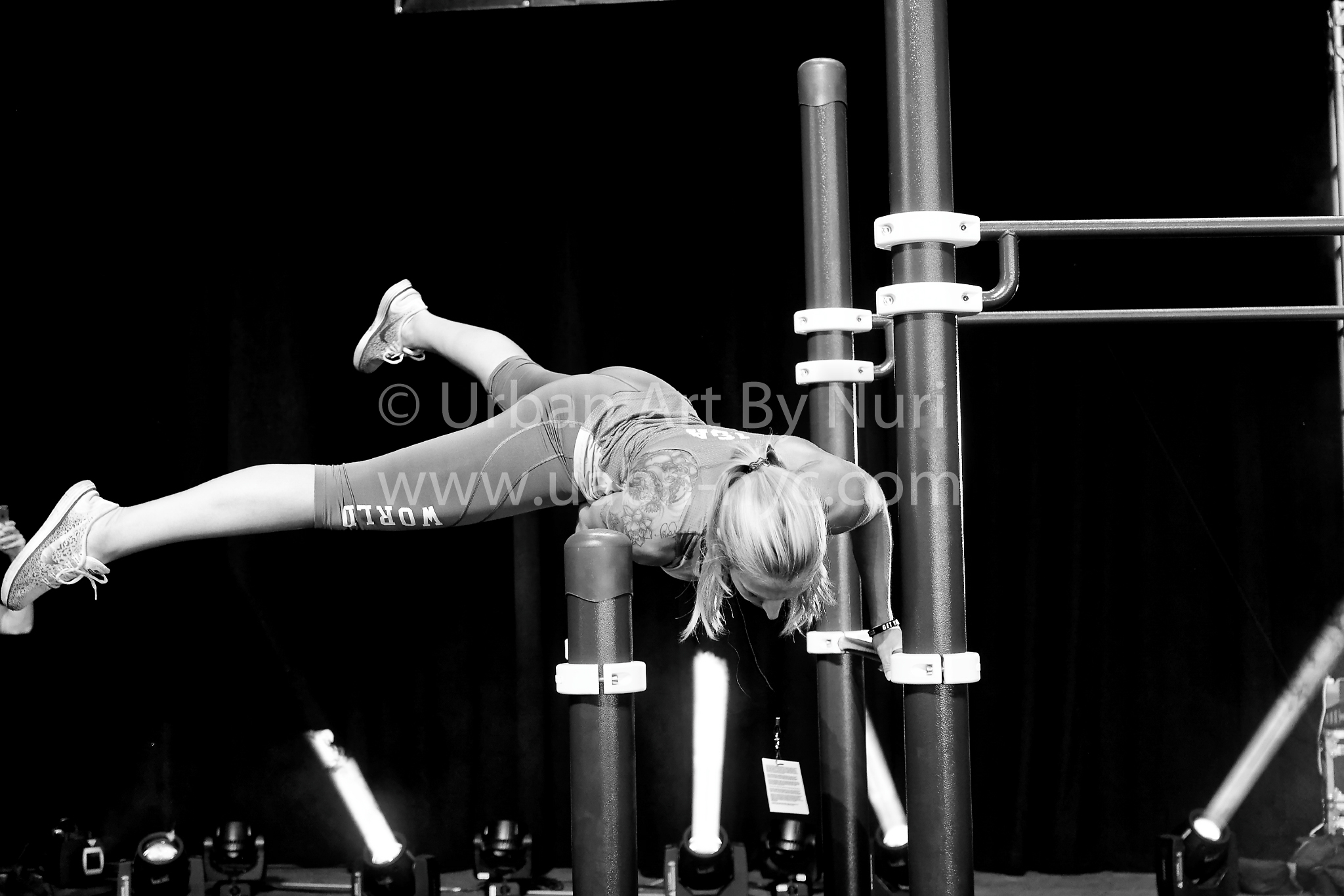 Awesome hot of UFL athlete Isa Bell of the World Team, performing a highly difficult balancing manuever on the dip bars.