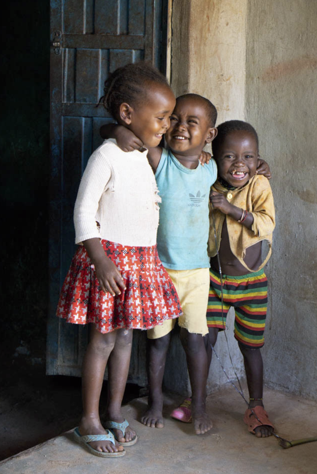 I photographed these three adorable children after hanging out at a local restaurant in Jinka, Ethiopia. I just sat and smiled and watched them play with each other and then eventually we had a game of hide-and-seek developing. Then after we developed this great connection, I took out my camera and began to photography. The photos come alive this way, too. There is a relationship that we all have that we did not when I first walked up to the establishment.