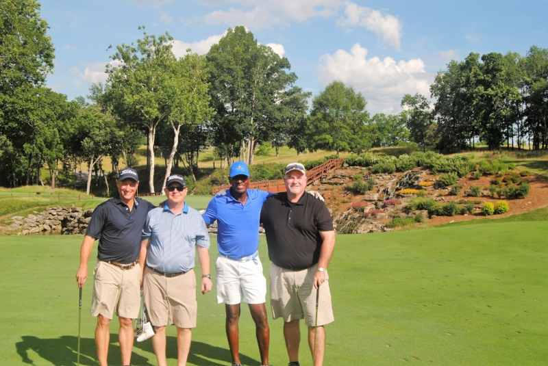 Kevin, James, me, and Richard in front of the 13th Green