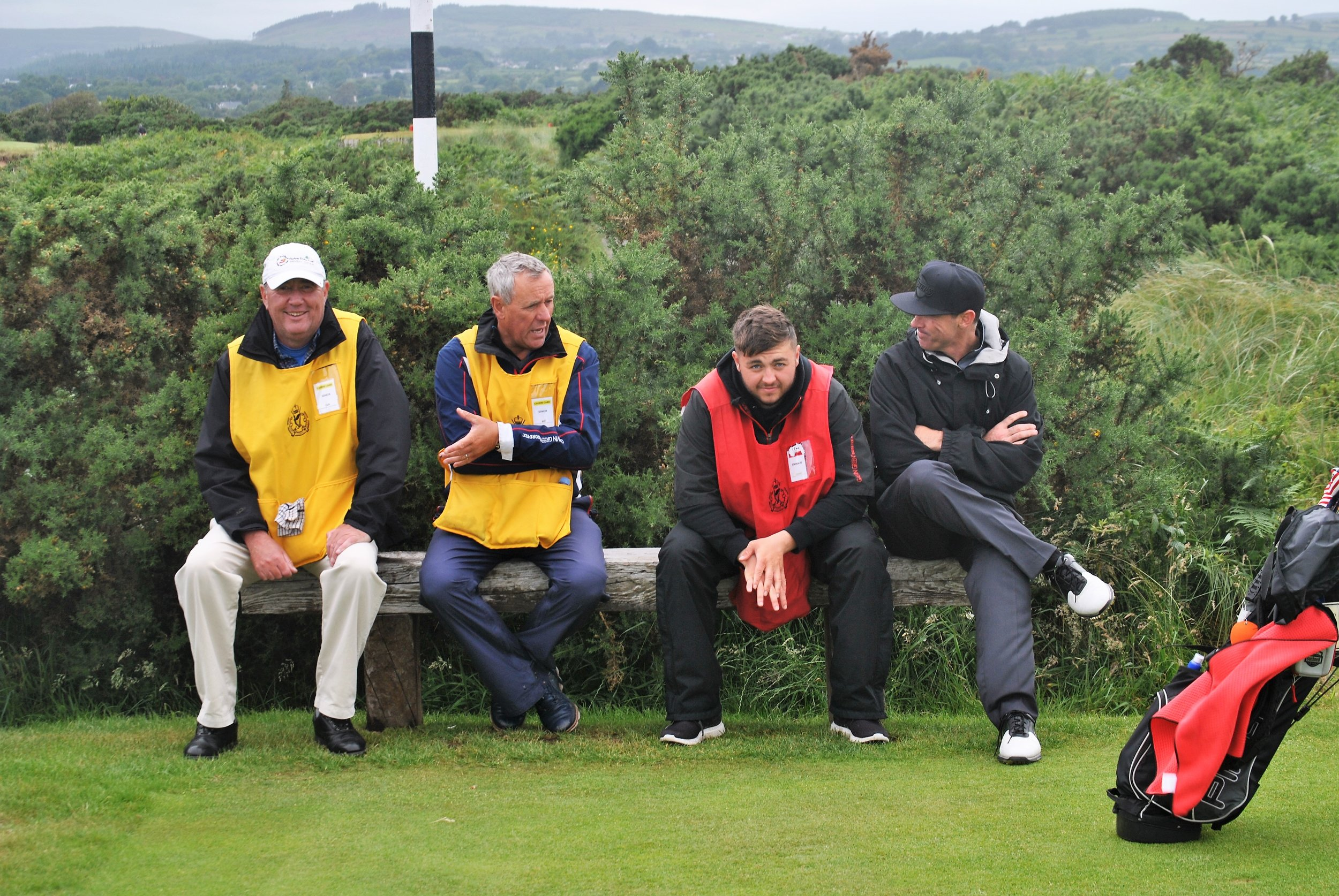 The caddies and Chad take a break while we wait to tee off on the Par 3 14th hole