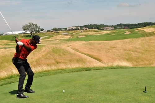 Hitting my drive on the final hole at Erin Hills
