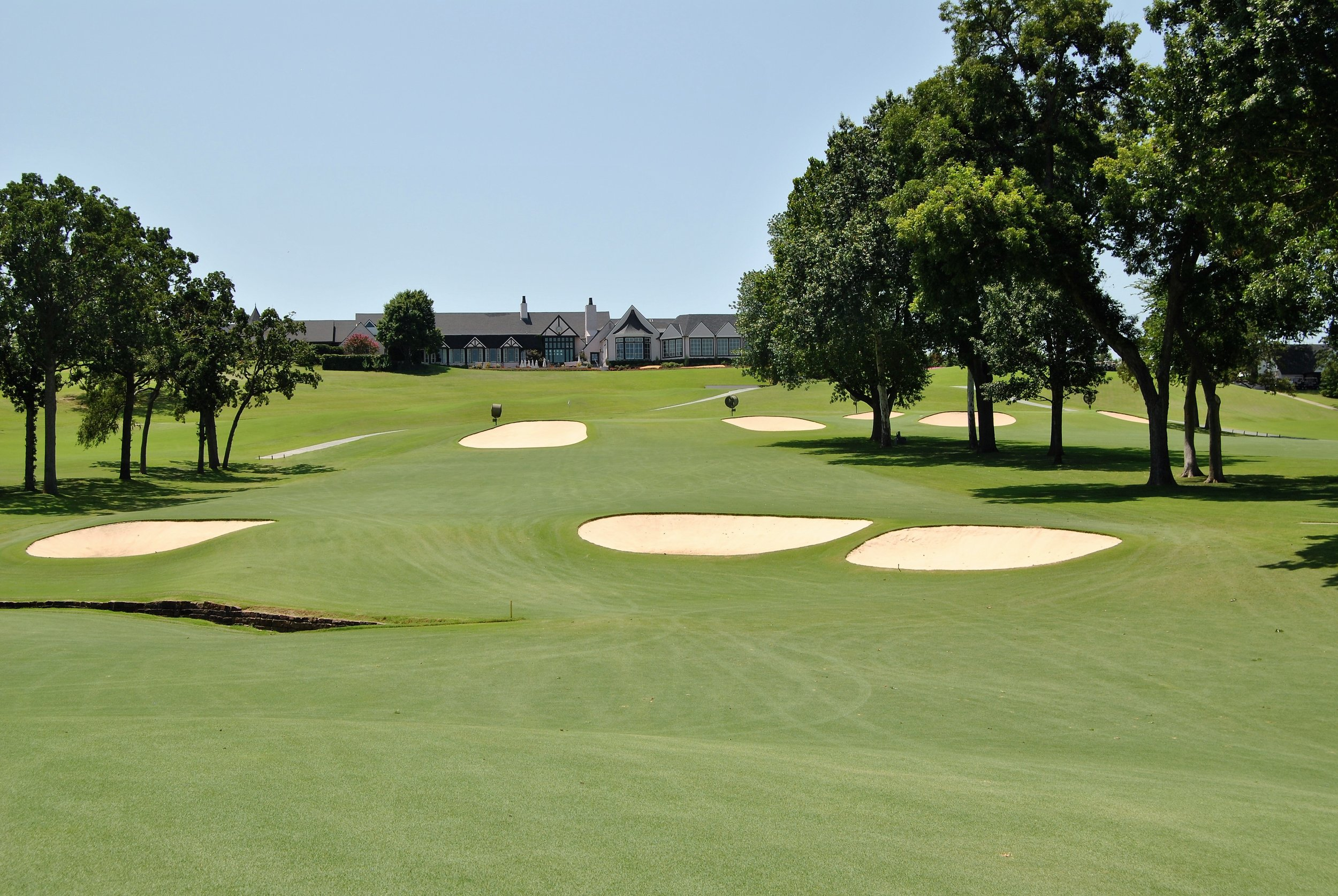 The approach to the 18th green with the country club in the background