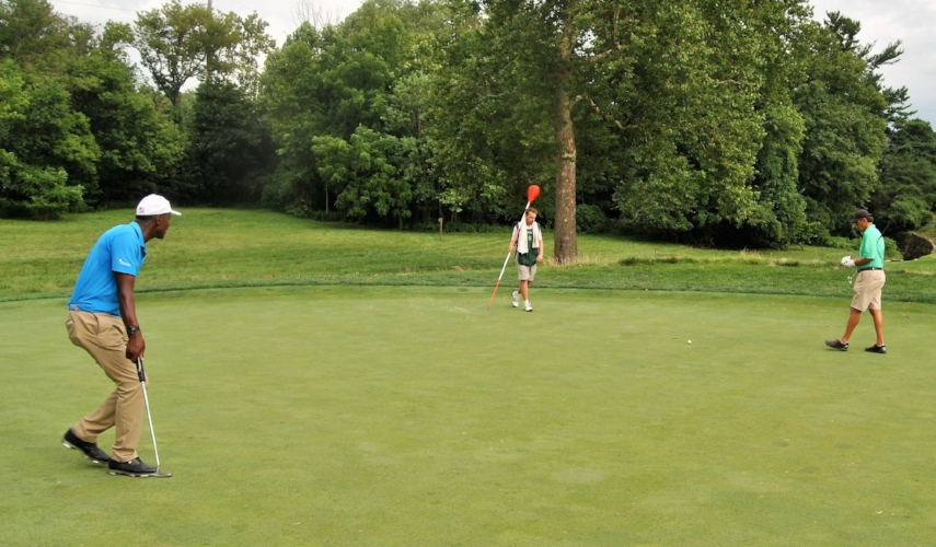 My putt on the 13th hole just misses to the right.