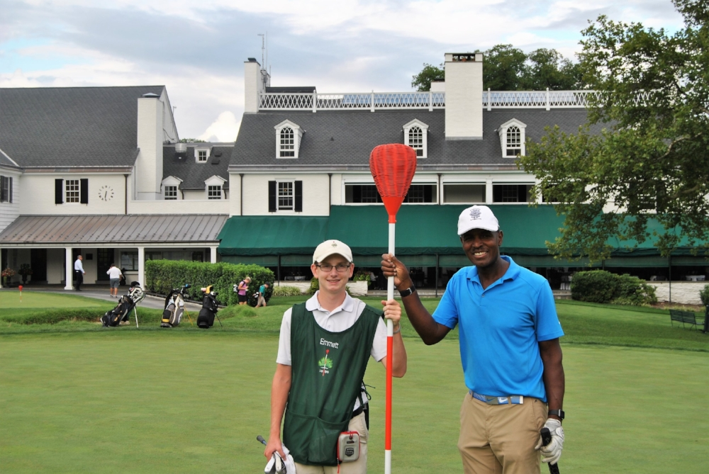 Emmett and I following holding the pin on the 18th hole