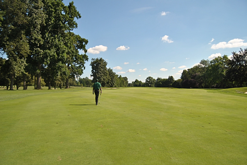 A nice long walk to the green with putter in hand on the 14th hole.
