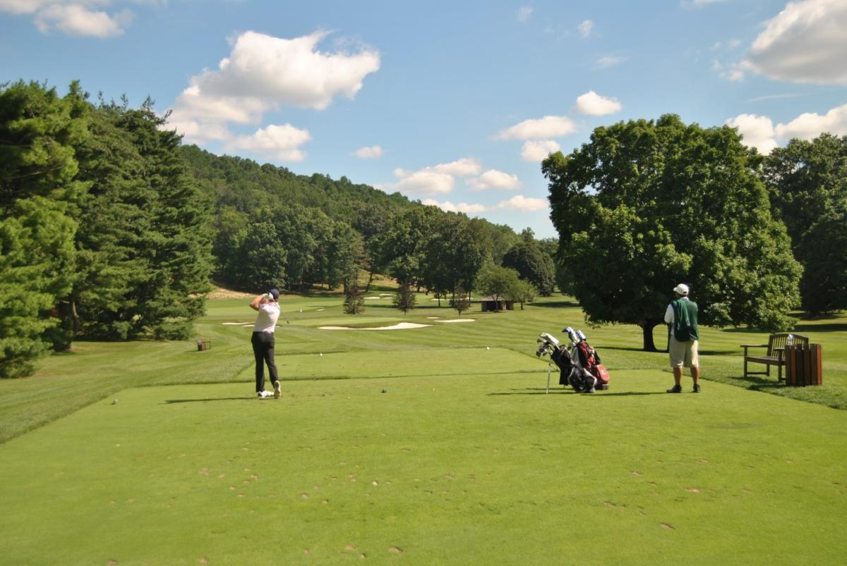 Beau hitting his tee shot on the 16th hole.