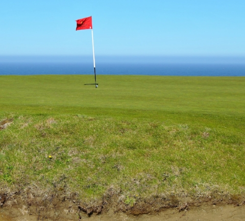 My pitch shot is resting just behind the flag in its shadow.