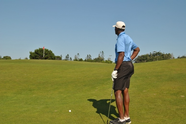 Thinking about how to chip the ball close to the flag with risking it coming back to me off the false front.