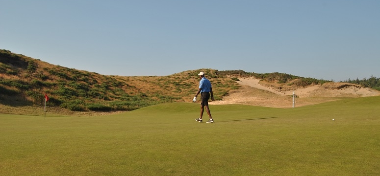 Studying the putt on the sixteenth green. My ball was pin high but 80 feet from the hole.