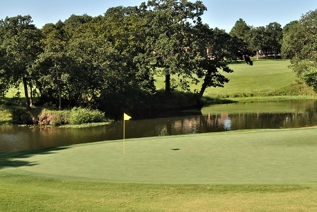 The ball is about 30 feet past the flag on the right side of the green.