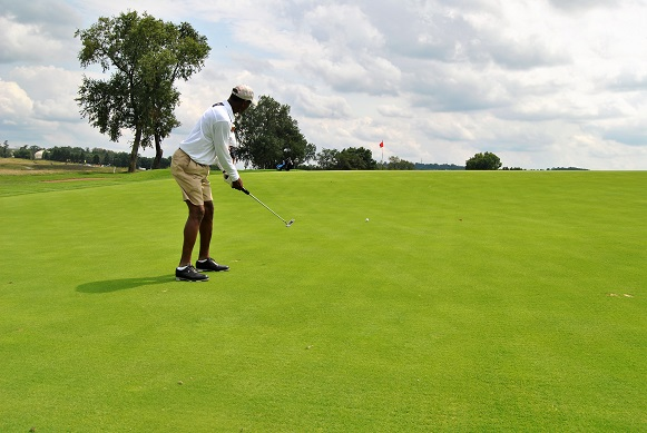 A long putt on a large green.