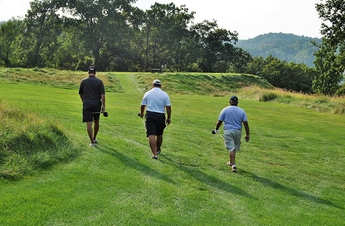 Jim E, J.C., and Ron L. walked to the 17th tee box.