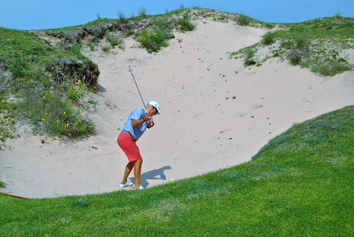 Tony hitting out of the deep fairway bunker on the 7th hole.