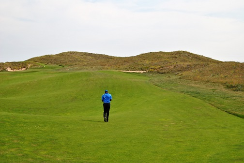 walking up the 8th fairway.