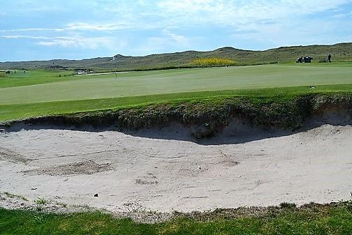 My approach shot landed in the green side bunker.
