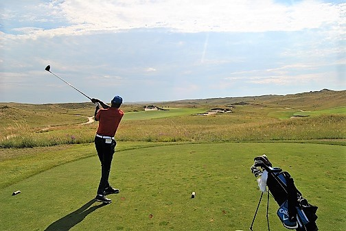 Hitting my drive on the seventh hole.