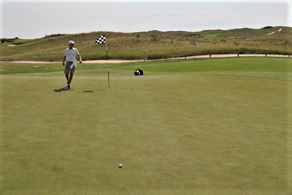 My approach shot landed 25 feet from the pin.