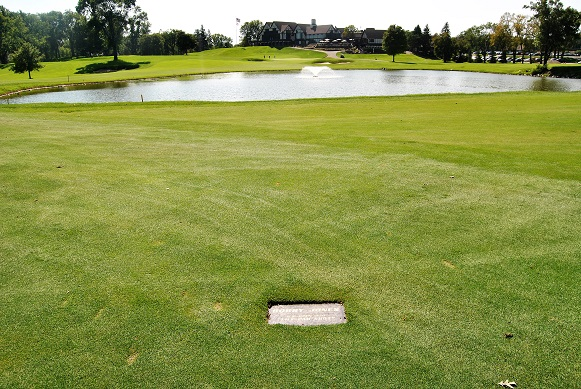 """The plaque marking where Bobby Jones hit his famous """"lily pad"""" shot from."""