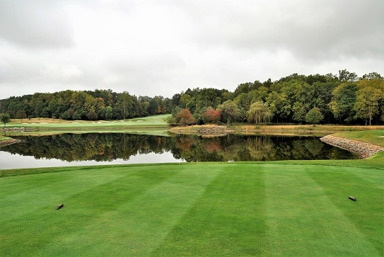 The fourth hole from the tee box looking at the long carry over the pond.