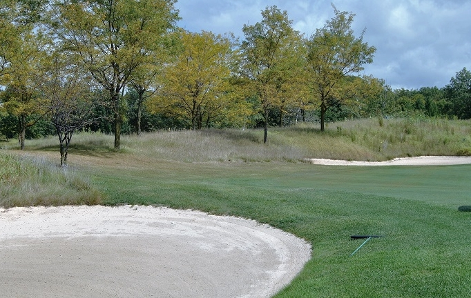With my ball close to the lip and the flag 165 yards away, I was fortunate to have a low lip in the fairway bunker.