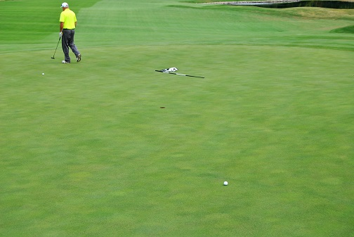 My pitch on the 14th hole left this downhill breaking putt for par.