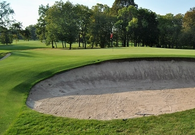 My tee shot landed in the bunker.
