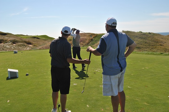 John and Frank watch as I hit my tee shot to the seventeenth green.
