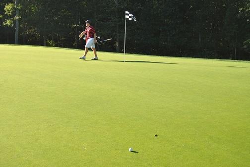 My tee shot. That's Drew walking across the green.