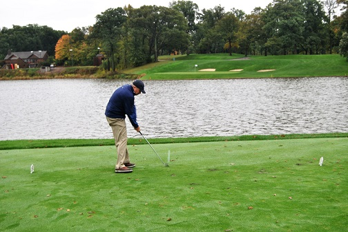 Bill hits his tee shot on the par three second hole.