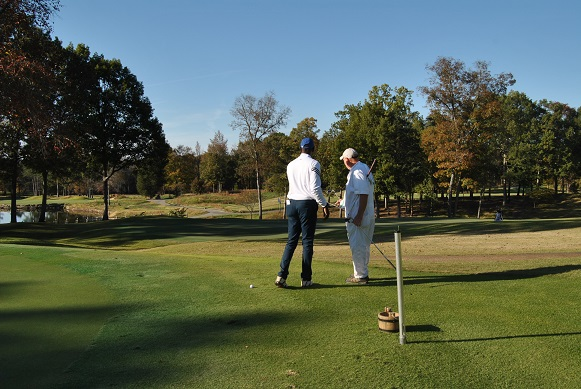 Discussing my options to get the ball from the putting green to the 18th green with Jack.