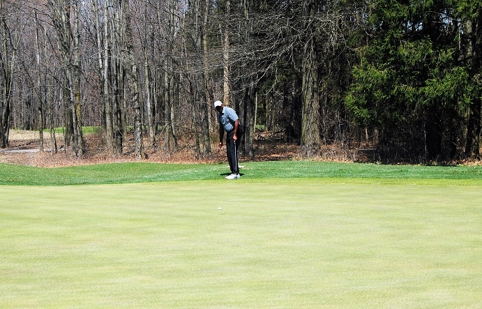 Kevin's birdie putt stopped just short of the cup.