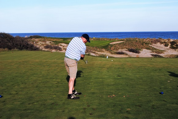 Geoff shows how to hit a tee shot on the green on this beautiful par three.