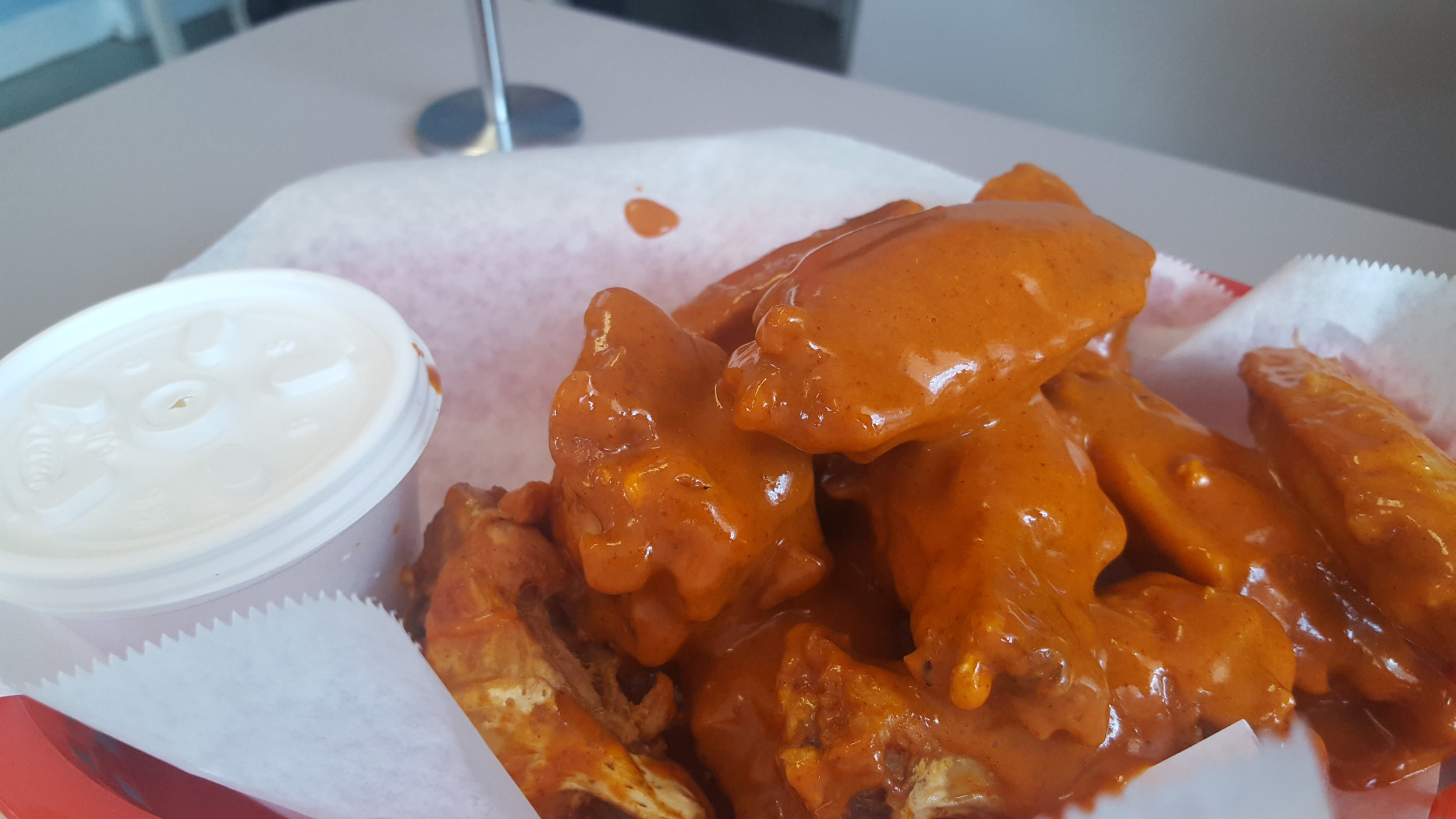 Buffalo Wings with Ranch Sauce.