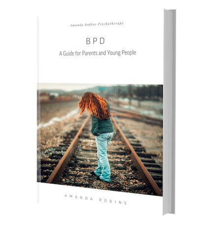 Free BPD Guide. Image of cover of book with young girl with red hair standing on railway track with her back to us.