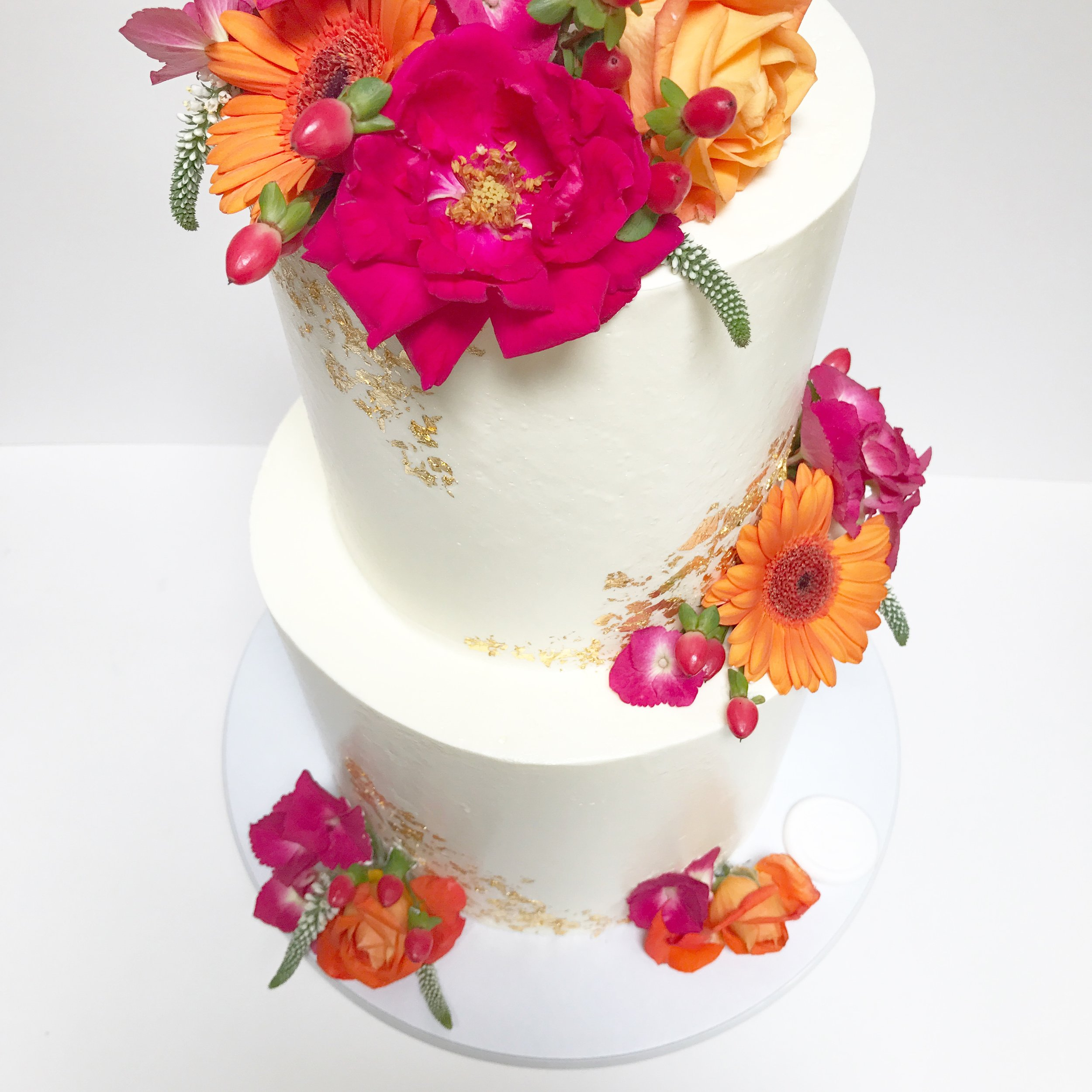 Vibrant flowers on white cake.JPG