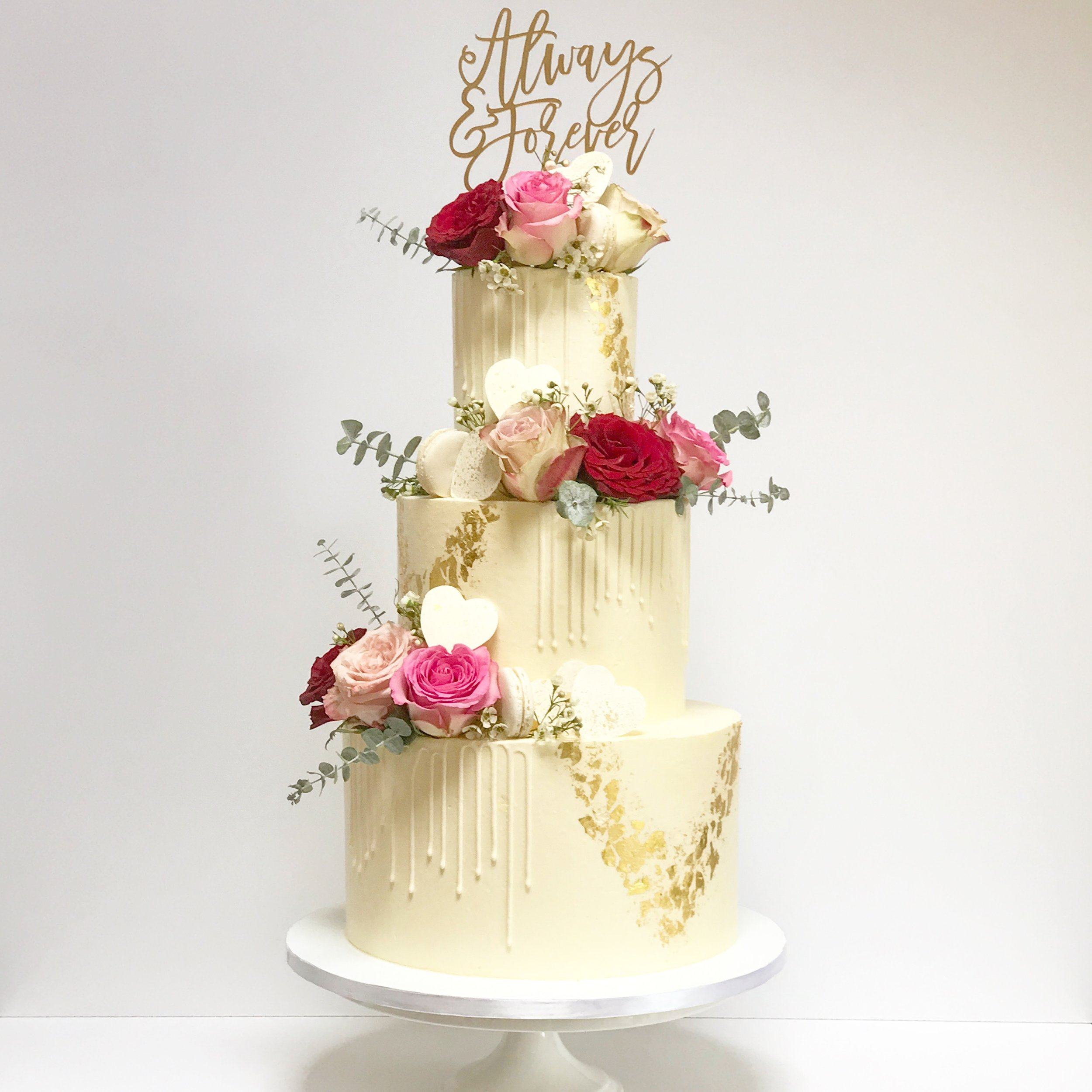 White on White Buttercream Drip Wedding Cake with Flowers.JPG