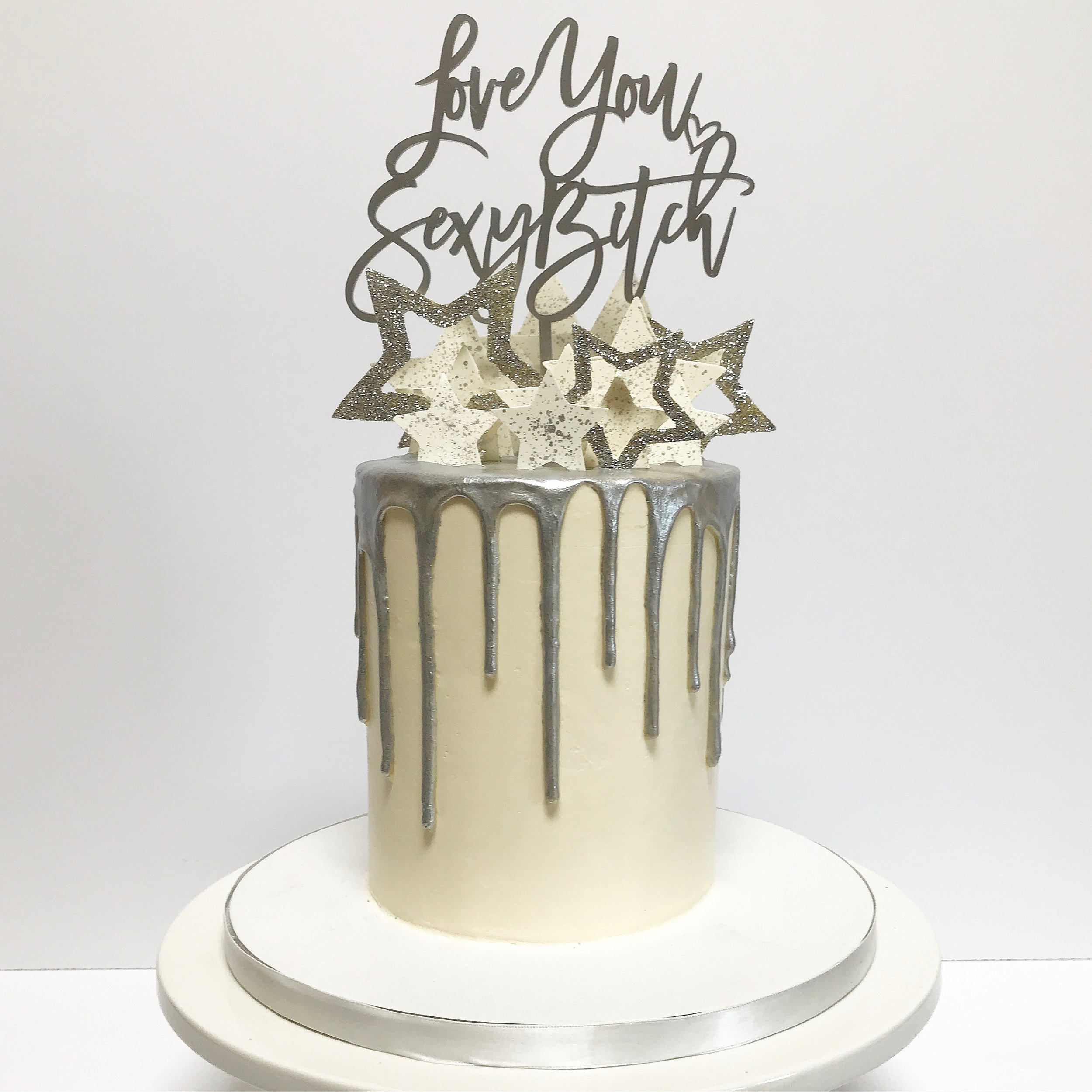 Silver drip buttercream cake with stars.jpg