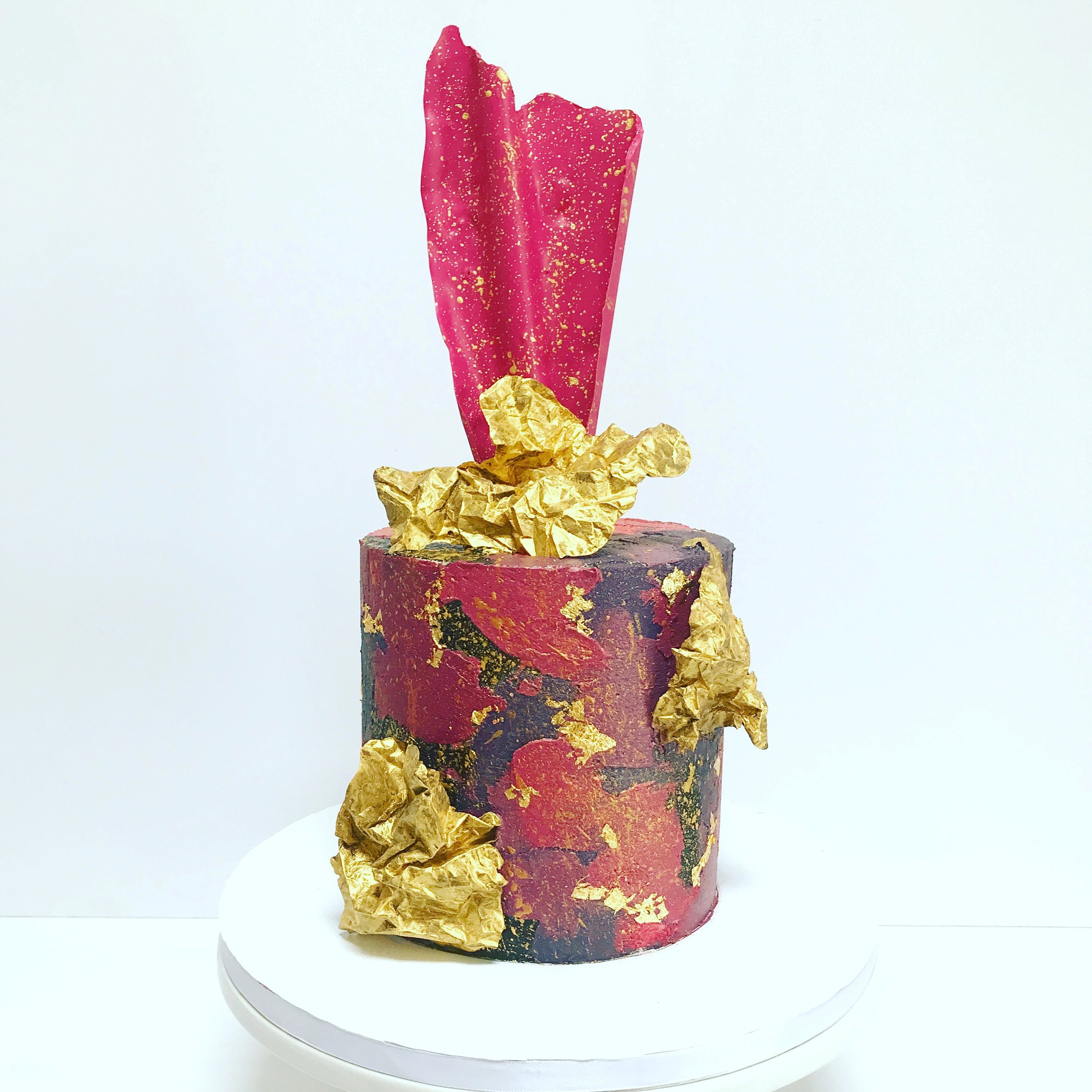 Pink, black and gold textured buttercream cake.JPG