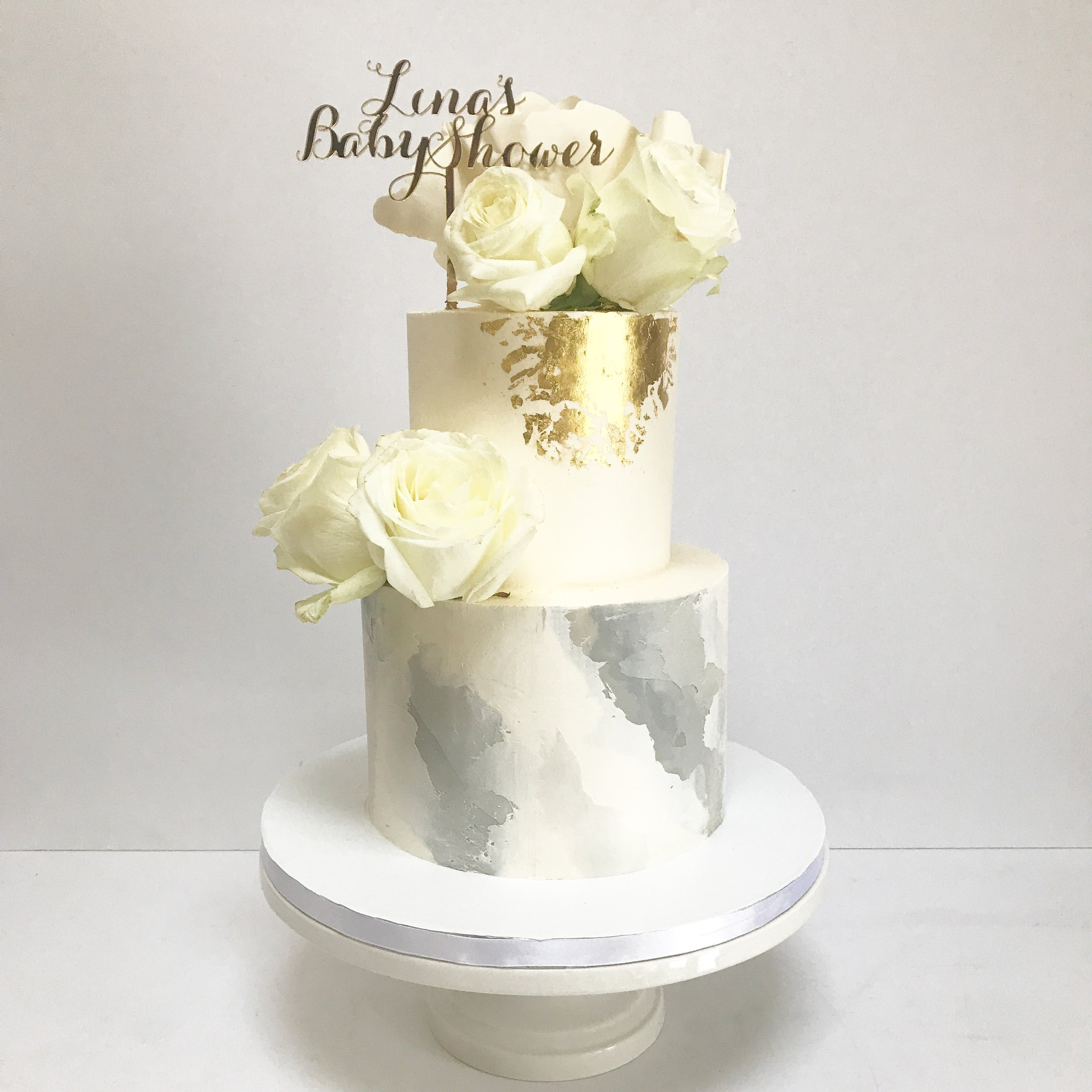 White, marble and gold buttercream baby shower cake.JPG