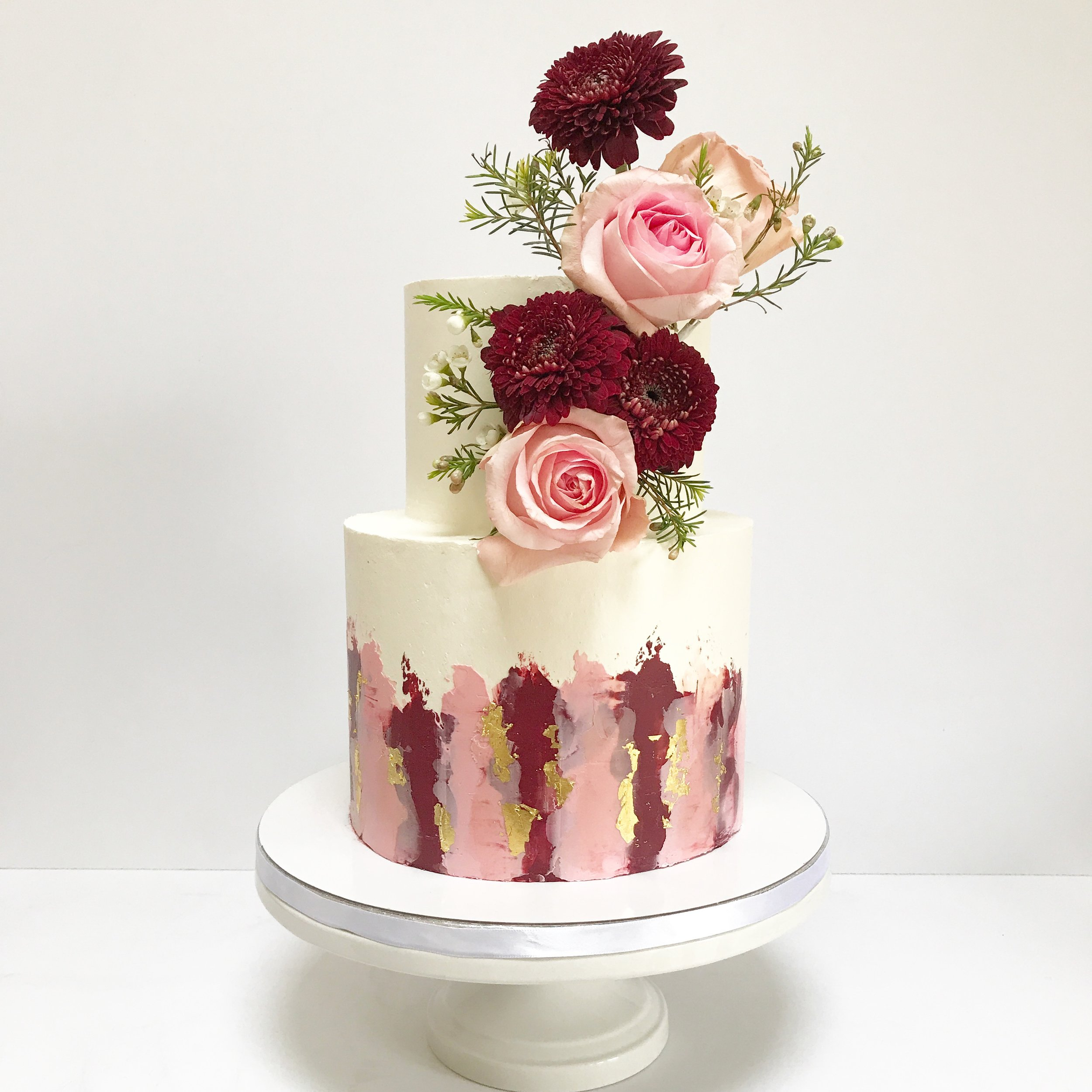Maroon and blush buttercream wedding cake with flowers.JPG