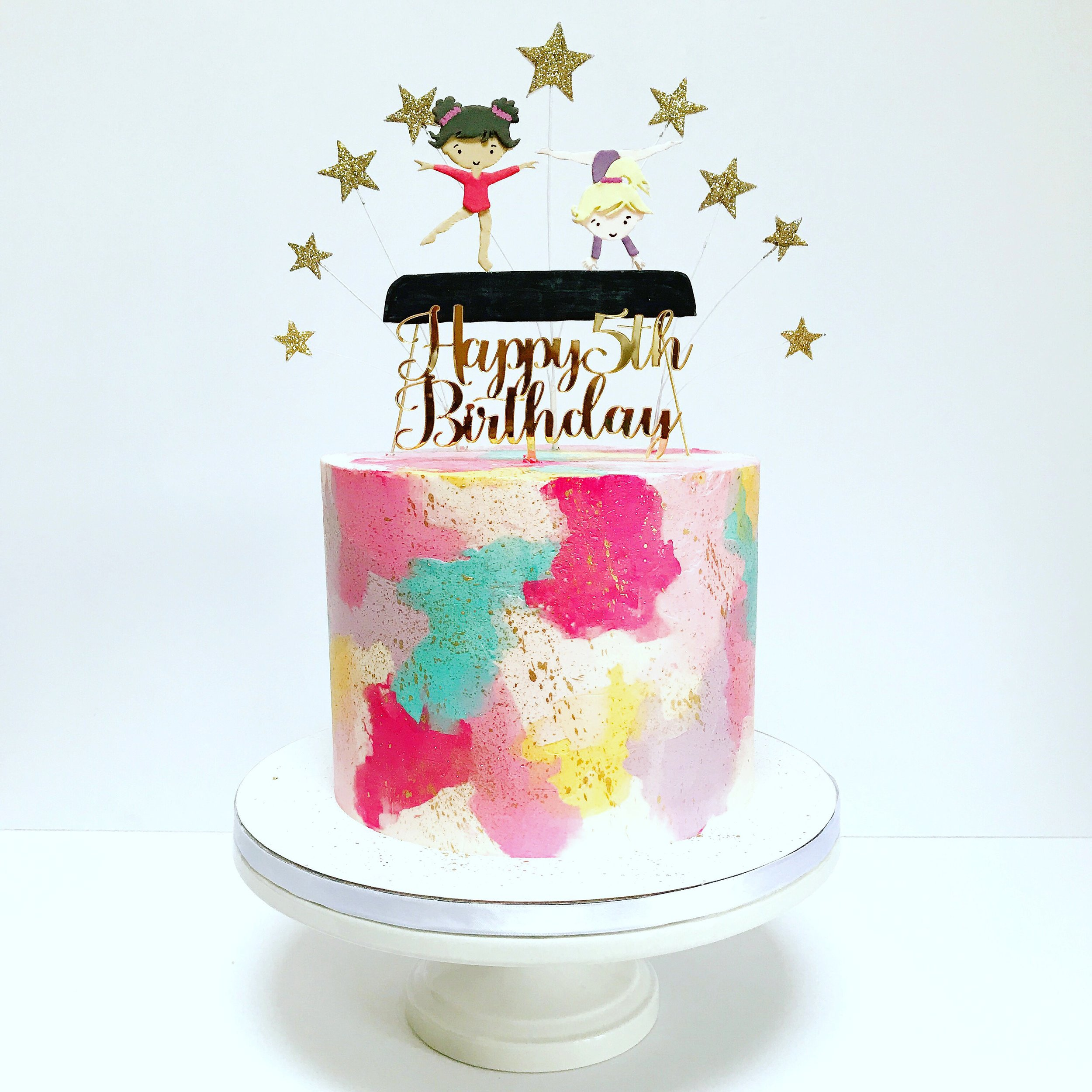 Gymnastics themed 5th birthday cake with watercolour buttercream.JPG