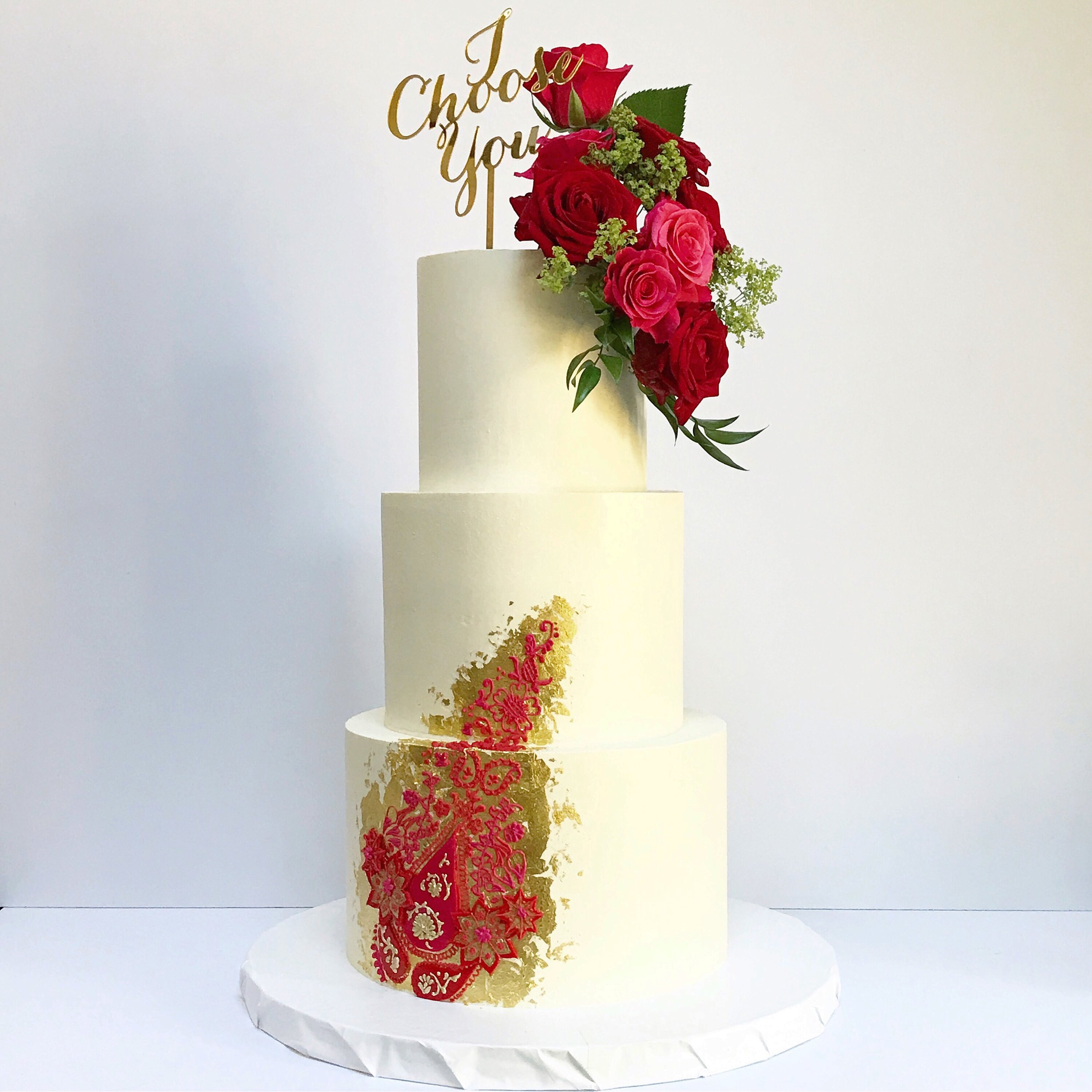 Red and pink henna piped gold leaf three tier wedding cake.JPG